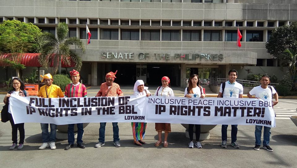"A photo of the indigenous peoples leaders at the Philippine Senate Building holding up a banner saying ""IP Rights Matter"". Photo by Loyukan"